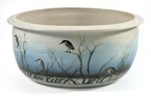 LARGE CERAMIC JARDINIÈRE Grisaille-decorated overall with herons perched on reeds against a pale blue sky. Indistinct inscription. D...