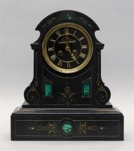 FRENCH SLATE-CASED MANTEL CLOCK Case with etched gilt design and four inlaid malachite panels. Black dial with gilt Roman numerals....