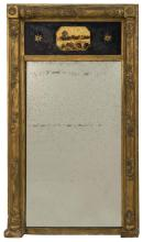 GILT SHERATON-STYLE MIRROR With upper tablet decorated with Baldwin Castle, Wexford, England. Fruit and flower-decorated pilasters....