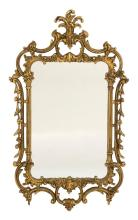 GILTWOOD CONTINENTAL-STYLE MIRROR With scroll design. Overall 50