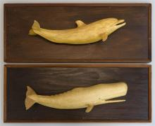 TWO WOOD PLAQUES By Robert Innis of South Dennis, Massachusetts. Both painted white with a brown patinated finish. 1) A sperm whale,...