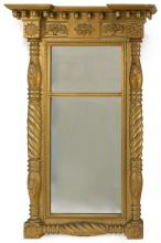 CLASSICAL GILT MIRROR Cornice with acorn drops. Pediment with raised baskets of fruit flanking a floral blossom. Same blossom repeat...