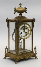 CRYSTAL REGULATOR CLOCK With enamel dial, Roman numerals and outside escapement. Four hoof feet and urn finial. Height 15
