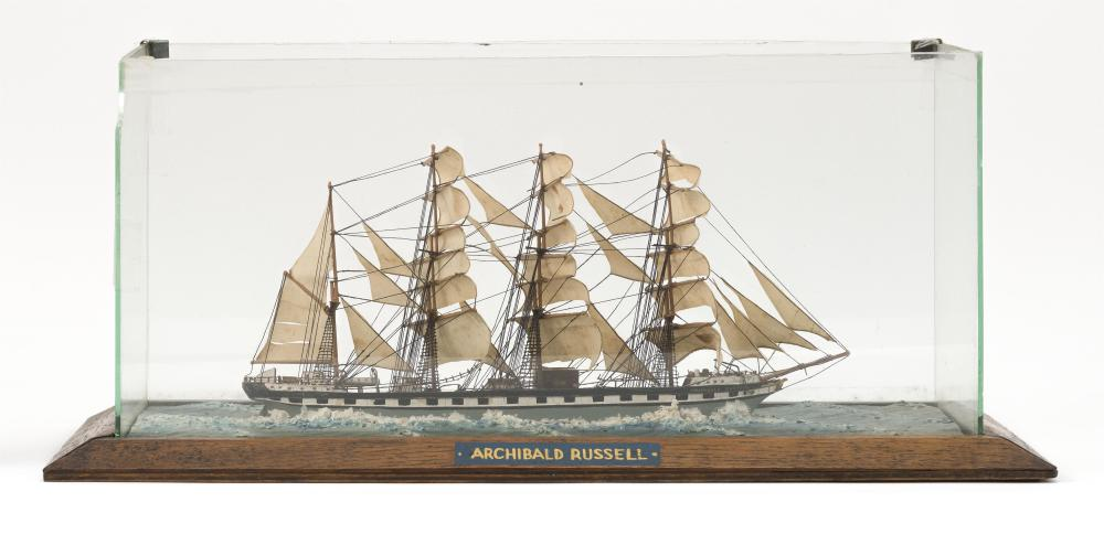 CASED MODEL OF THE FOUR-MASTED BARK ARCHIBALD RUSSELL Black hull with false gunports. Fitted with sails. Set into molded water on a...