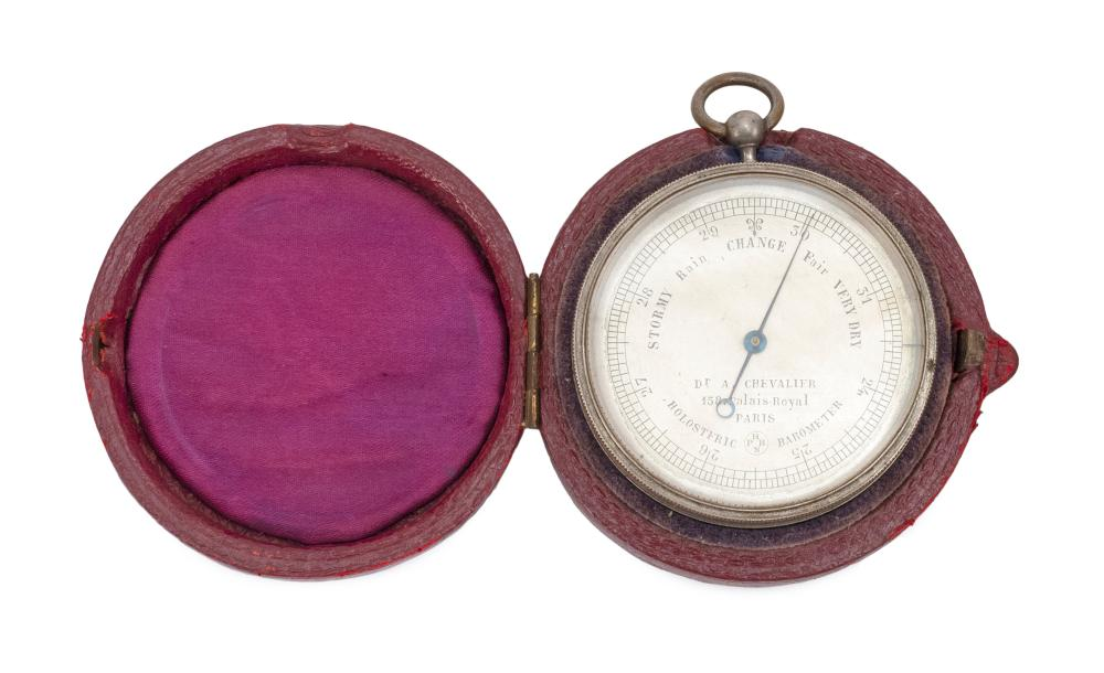 """CASED HOLOSTERIC POCKET BAROMETER Made for the British market. Silvered face marked """"Stormy Rain Change Fair Very Dry"""" in English. A..."""