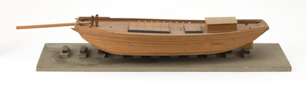 """BUILT-UP MODEL OF A WEST COAST SCOW SCHOONER Fitted with tiller but no masts or rigging. Natural wood finish. Height 5"""". Length 27""""...."""