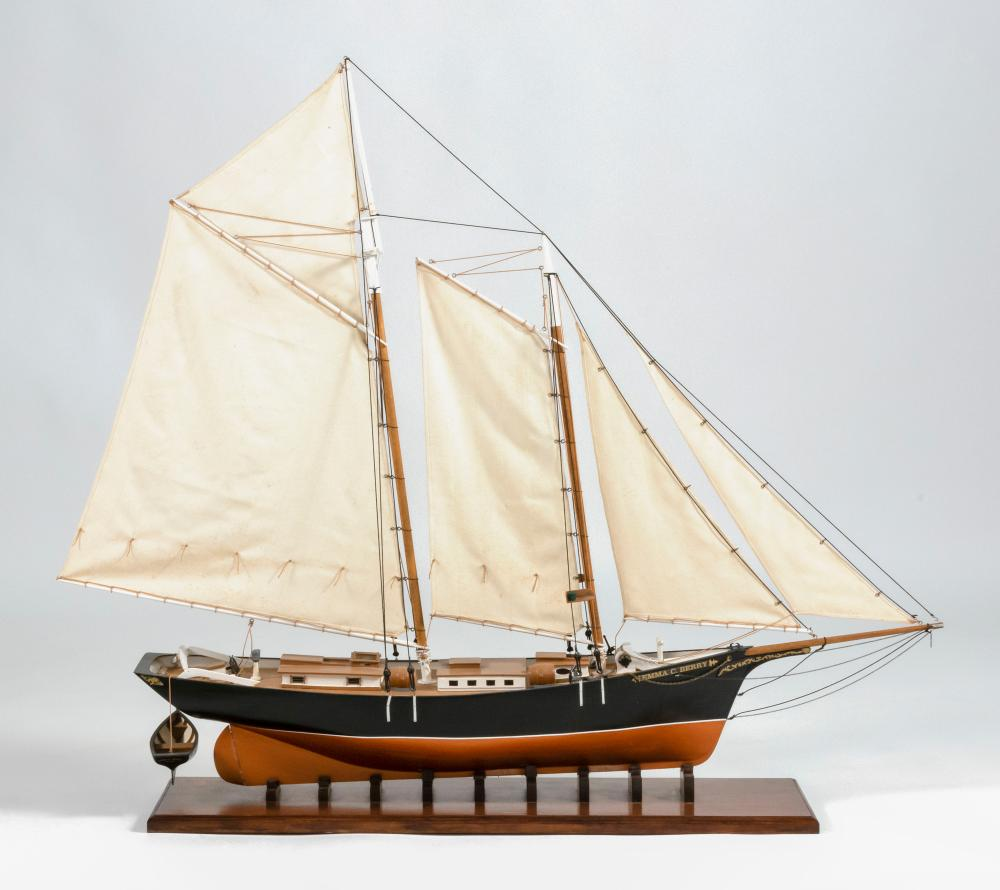 MODEL OF THE EMMA C. BERRY Built up wood hull with a painted red bottom, white waterline and black topsides. Vessel's name lettered...