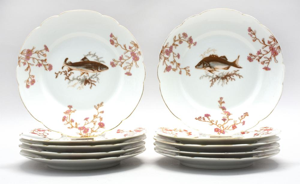 TEN BAWO DOTTER LIMOGES PORCELAIN PLATES Polychrome transfer decoration of a central fish surrounded by pink flower sprays. Factory...