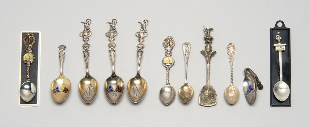 ELEVEN AMERICA'S CUP COMMEMORATIVE SPOONS Seven in sterling silver and four silver plated. Several with enameled burgees, relief dec..