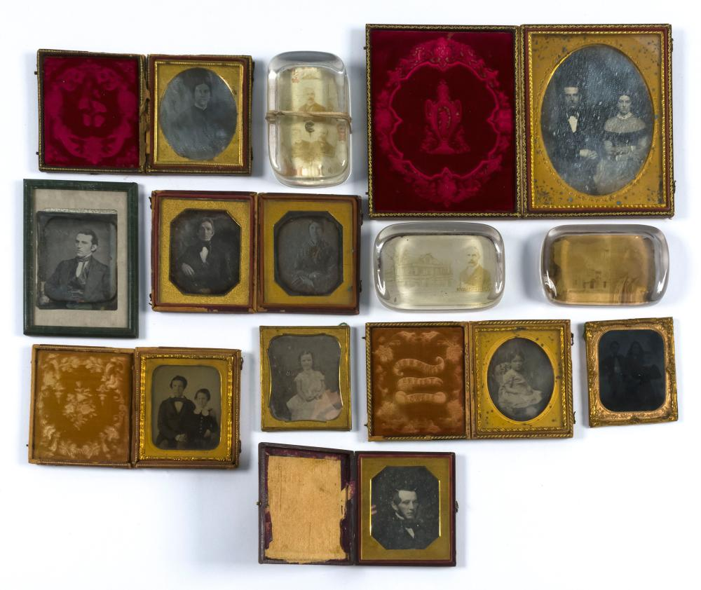 THIRTEEN EARLY PHOTOGRAPHS Ten tintypes, ambrotypes, etc., mostly in leather cases, and three glass paperweights. Depict men, women,...