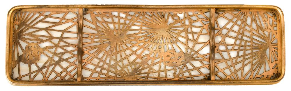 TIFFANY STUDIOS SLAG GLASS AND DORE BRONZE PINE NEEDLE PEN TRAY With caramel-colored glass. Impressed marks. Numbered 1004. Length 9...