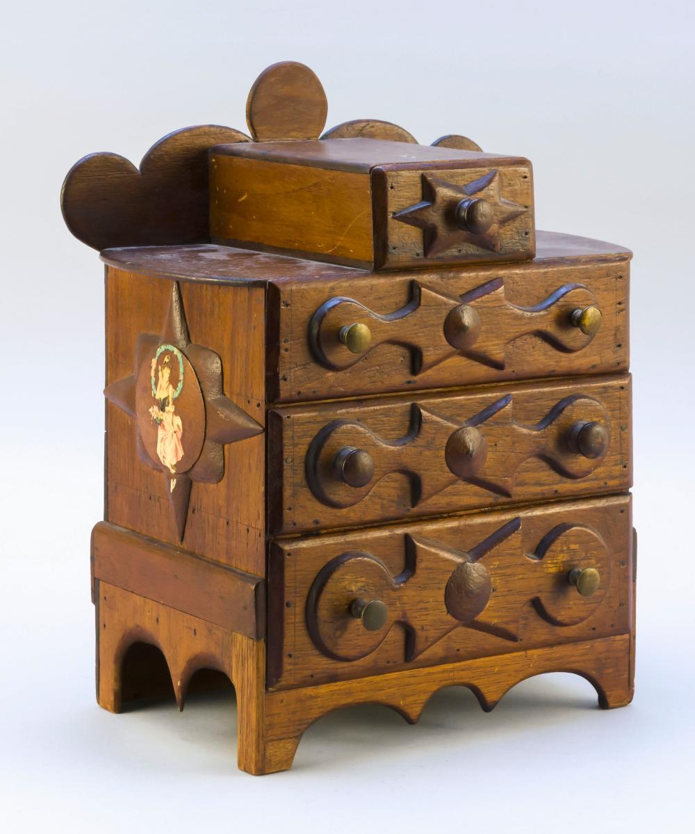 MINIATURE TRAMP ART-STYLE BUREAU With shaped backsplash, a small surmounted drawer, three full-width drawers and a shaped apron. Dra...