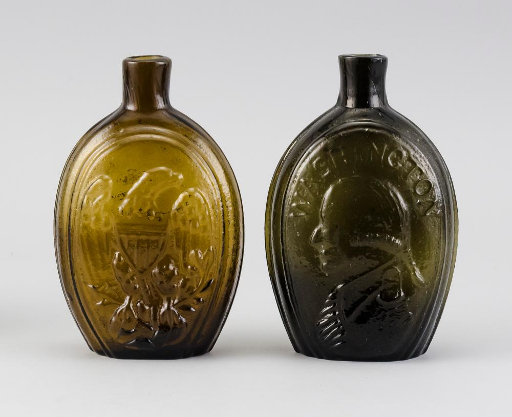 TWO HISTORICAL GLASS FLASKS One with an American eagle and a cornucopia (McKearin GII-73) and the other with busts of Washington and...
