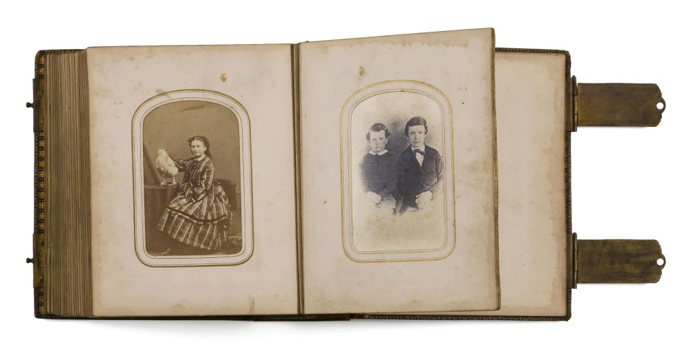 """ALBUM OF APPROX. 42 PHOTOGRAPHS Many photographs are hand-colored and depict children. Inscribed on album """"Sept. 1864 Bought in Phil..."""