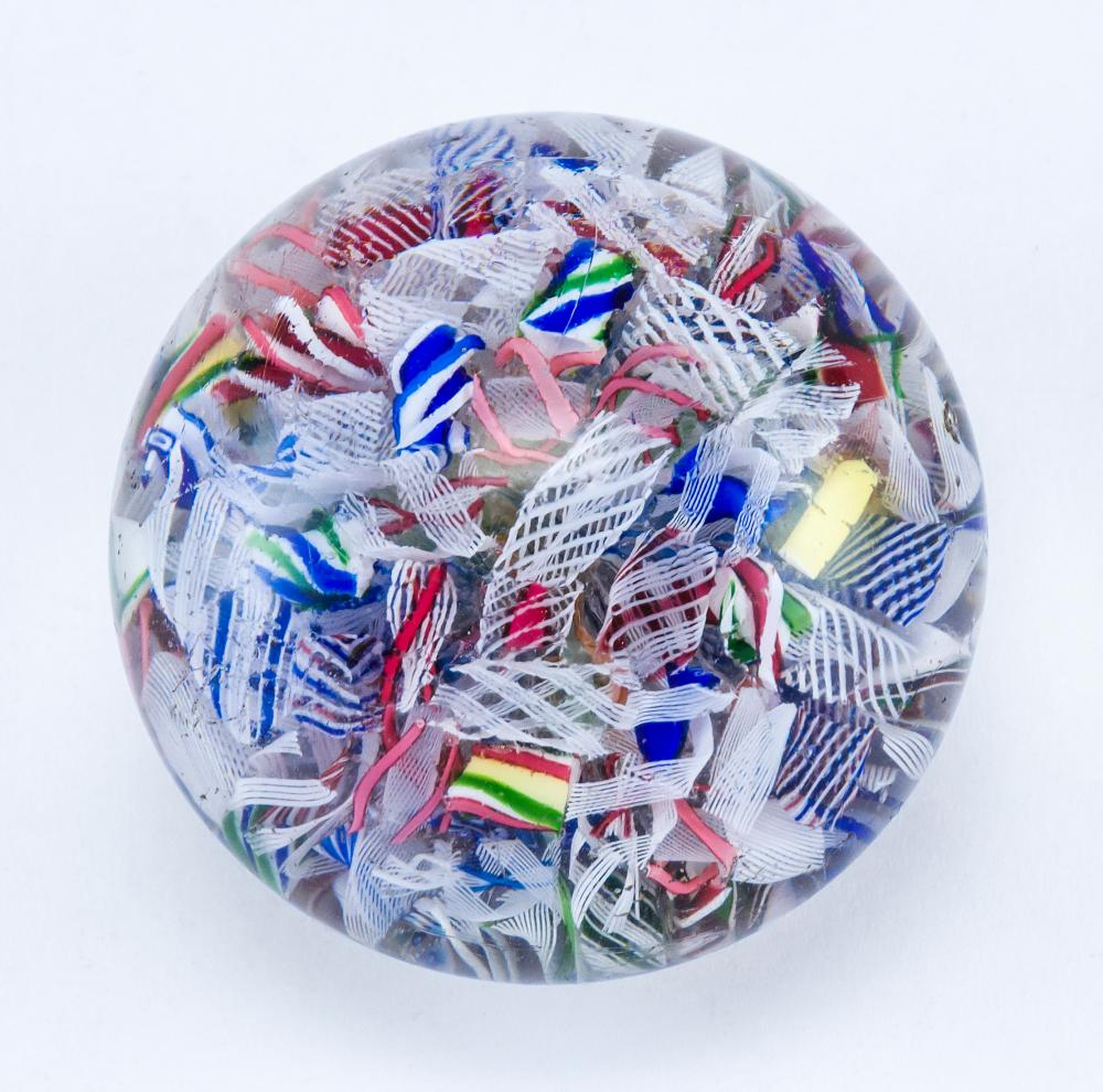 """SANDWICH GLASS SCRAMBLE PAPERWEIGHT Interior filled with multicolored cane segments. Unsigned. Diameter 2""""."""