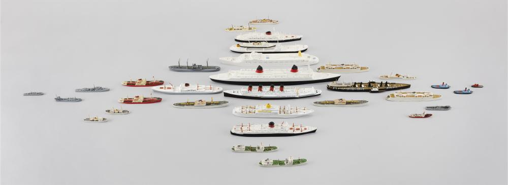 COLLECTION OF 33 MINIATURE WATERLINE SHIP MODELS 1:1200 scale. All in cast metal and painted, except as noted. Largest ship length 1...