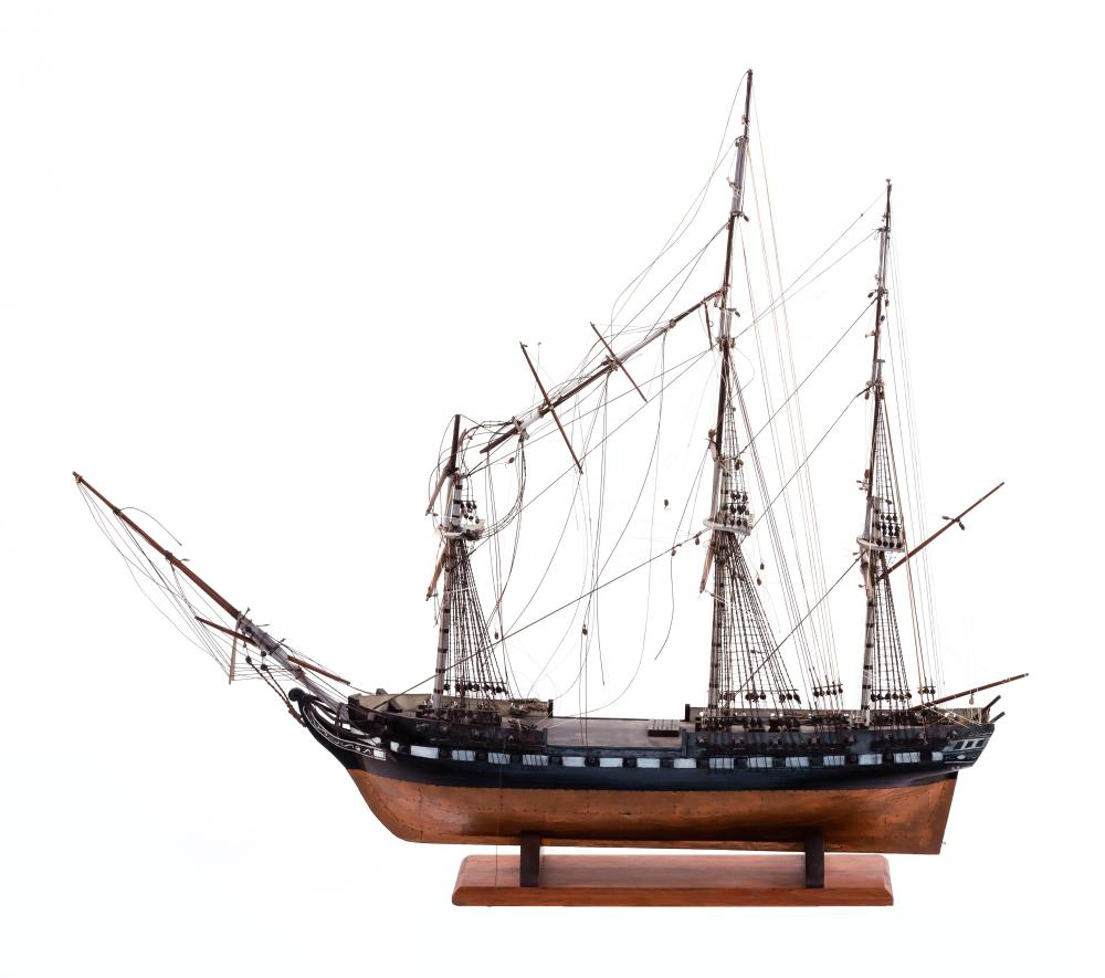 MODEL OF THE U.S.S. CONSTITUTION Wooden hull painted with a copper bottom, black topsides and a white gunport waist band. Well-detai...