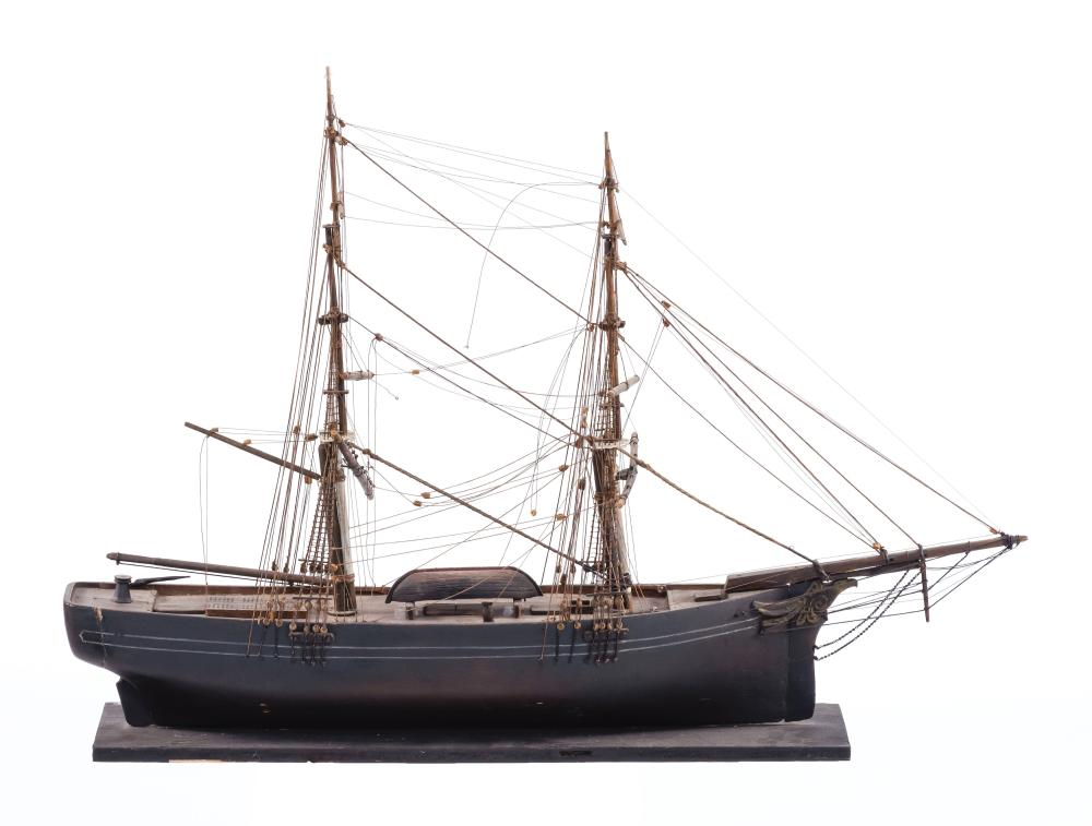 SAILOR-MADE MODEL OF THE BRIG DASH Built up from the solid. Hull with red bottom, black topsides and two white sheer stripes. Fitted...