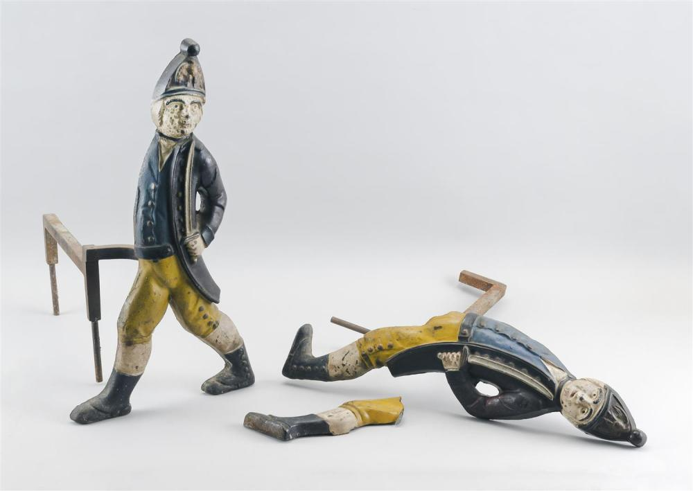 """PAIR OF HESSIAN SOLDIER POLYCHROME-ENAMELED CAST IRON ANDIRONS Stamped on reverse. Heights 19.5""""."""