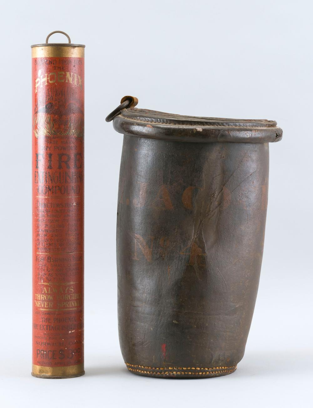 """TWO FIRE-RELATED ITEMS A leather fire bucket with faint markings, height 12.5"""", and a Phoenix Dry Powder Fire Extinguishing Compound..."""