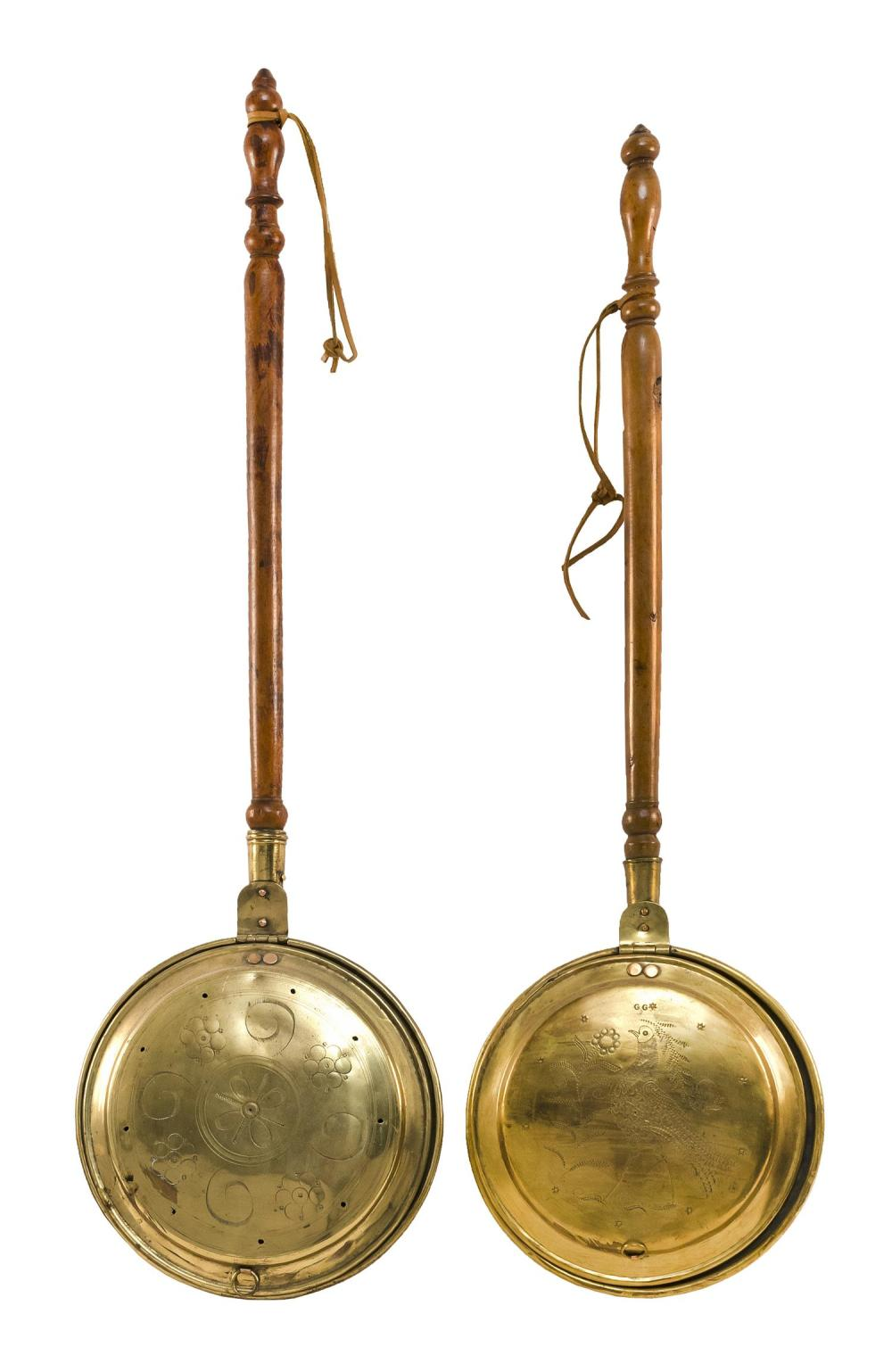 """TWO BRASS BED WARMERS One with a grain-painted handle and geometric design, length 43"""", and one with peacock and flower design, leng..."""