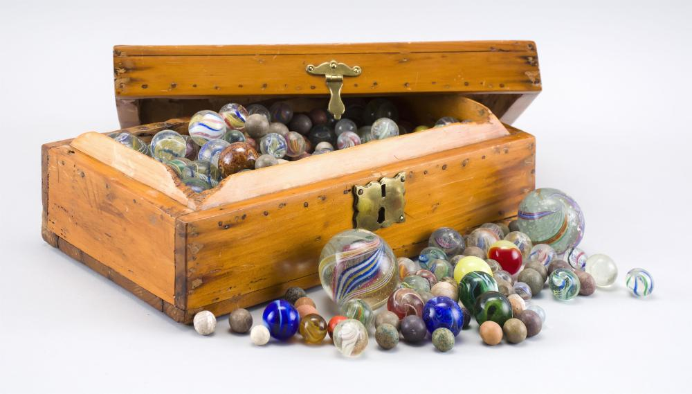 APPROX. 300 GLASS AND CLAY MARBLES Includes approx. 75 19th Century swirl glass marbles. Contained within a 19th Century wooden docu...