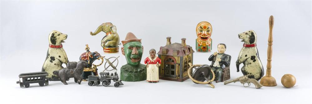 """FIFTEEN ASSORTED TOYS AND BANKS 1) Novelty mechanical bank in original paint. Height 6.75"""". 2) Humpty-Dumpty mechanical bank. Height..."""