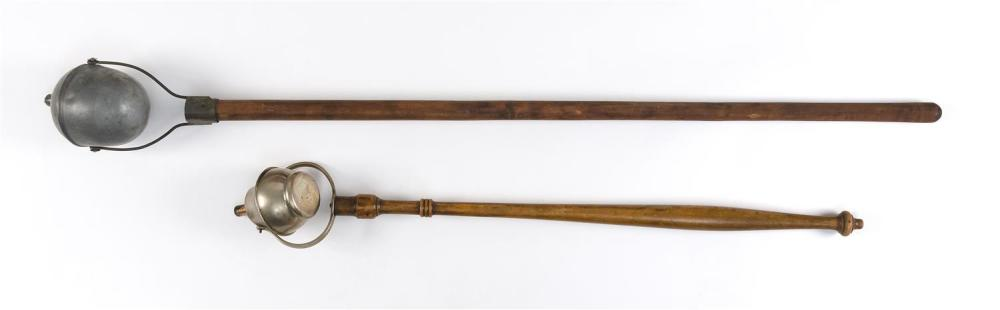 """TWO PARADE TORCHES One pewter and one nickel-plated. Both with wooden handles. Lengths 40"""" and 29""""."""