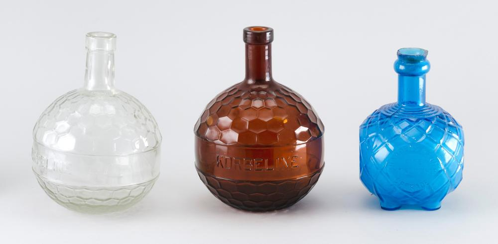"""THREE GLASS HAND GRENADE FIRE EXTINGUISHERS One clear, one turquoise and one amber. Heights from 5.5"""" to 7.5""""."""
