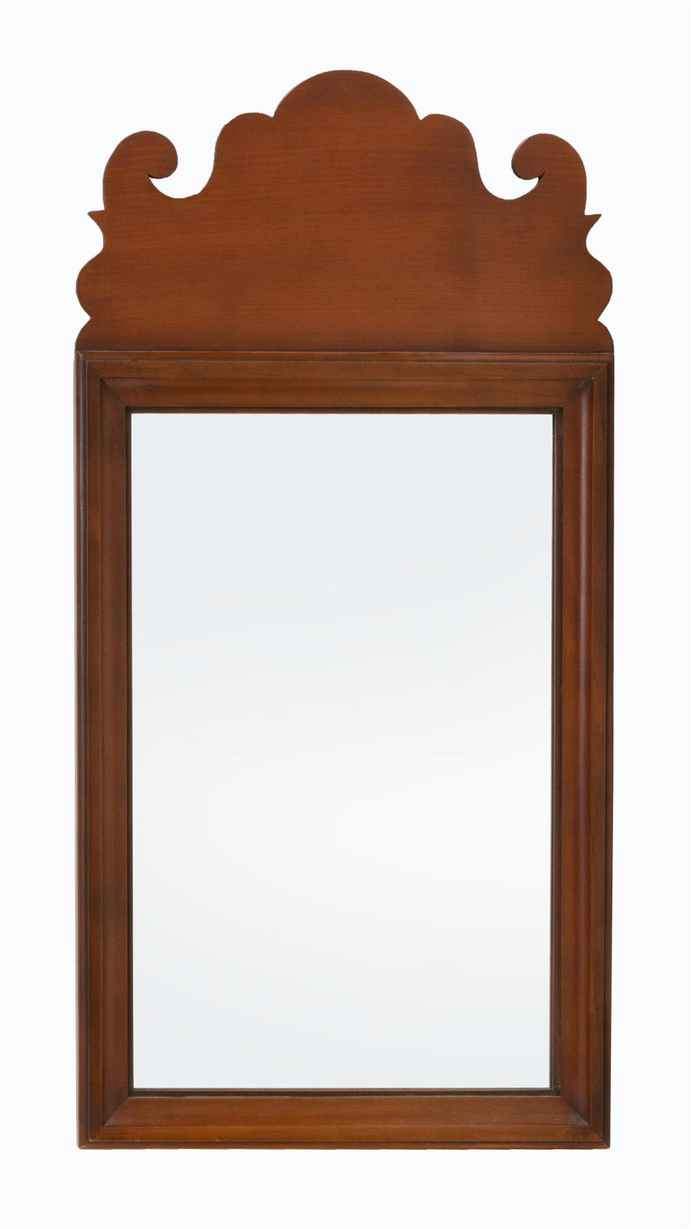 ELDRED WHEELER CHIPPENDALE-STYLE PIER MIRROR Carved and scrolled crest. Rectangular molded frame. Branded and with paper label on th...
