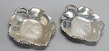 TWO REED & BARTON STERLING SILVER CANDY DISHES Both in the form of a grape leaf. Monogrammed on back. Lengths 7
