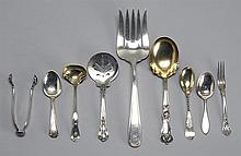 NINE PIECES OF STERLING SILVER FLATWARE By various makers. Includes a cold meat fork, a berry spoon, a jelly slice, a cream ladle, a...