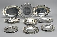 NINE PIECES OF STERLING SILVER HOLLOWWARE By various makers. Includes two bread baskets, two card trays, three candy dishes and two...