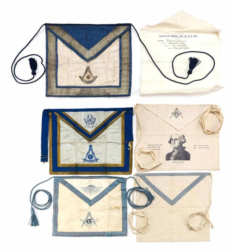 SIX MASONIC APRONS Contained within a rolled case and a flat