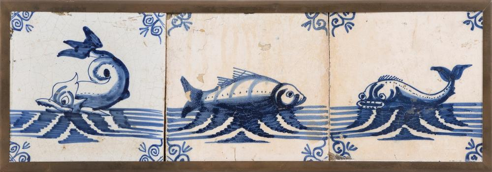 """THREE BLUE AND WHITE DELFT TILES SET IN A BRASS FRAME 17th/18th Century Framed 5.25"""" x 15.75""""."""