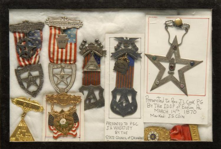 EIGHT ASSORTED FRATERNAL MEDALS Two attached to placards with presentation history. Housed in a simple shadow box frame 8.25