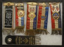 SIX ASSORTED FRATERNAL RIBBON BADGES Five suspended from medals. Three from the Junior Order of United American Mechanics (Jr. O.U.A...