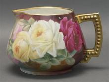 JEAN POUYAT LIMOGES HAND-PAINTED PITCHER Decorated with a bouquet of roses against an ombré ground. Unsigned. Height 5.5