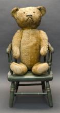 MOHAIR BEAR Together with a child''s chair painted blue with floral decoration. Height 17