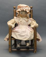 PAINTED CLOTH DOLL Together with a antique rush-seat ladderback child''s armchair, height 24