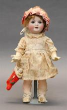 GERMAN BISQUE-HEAD DOLL With brown wig, blue eyes and open mouth. Composition body. Dressed in a white floral dress and holding a Fr...