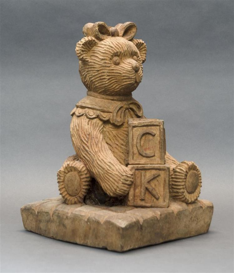 CARVED WOODEN SCULPTURE OF A TEDDY BEAR WITH BLOCKS On a square base. Height 15.25