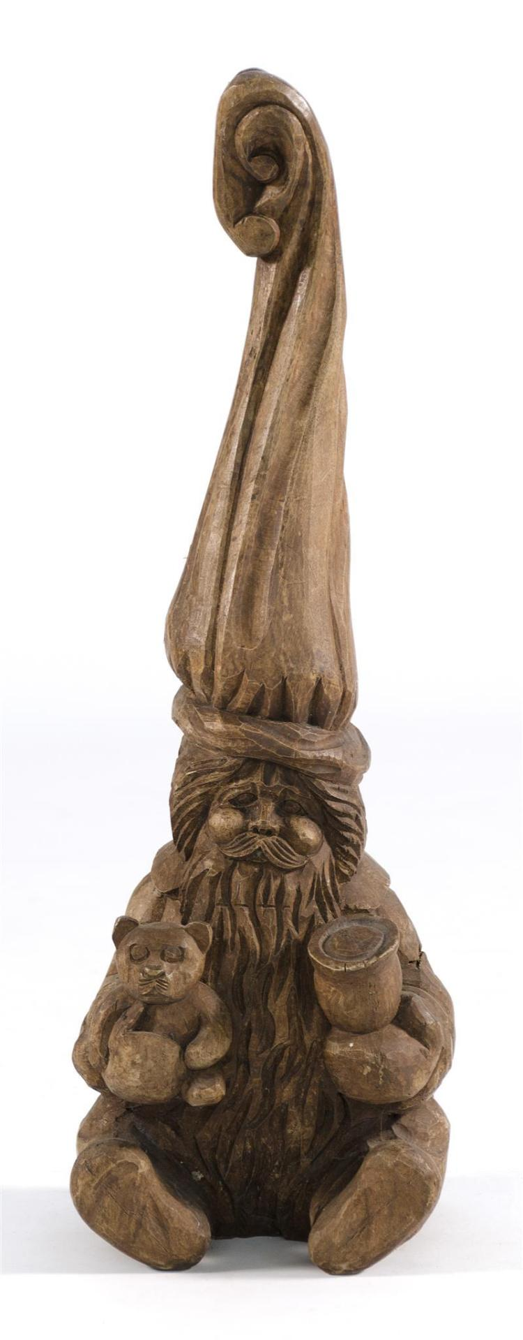 CARVED WOODEN FIGURE OF A GNOME HOLDING TOYS Height 24