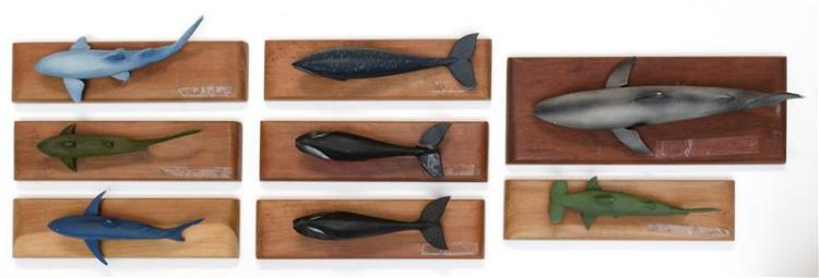 COLLECTION OF EIGHT CARVED AND PAINTED WOODEN WHALES AND SHARKS Maker unknown. Mounted to wooden bases. Lengths from 6