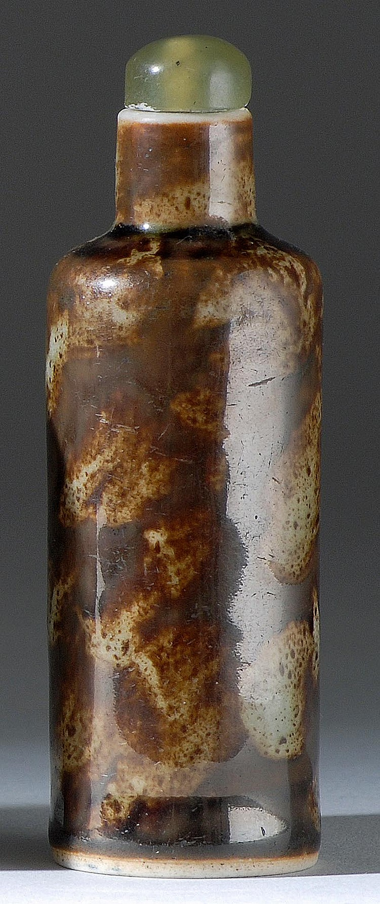 PORCELAIN SNUFF BOTTLE In cylinder form with brown and gray glaze simulated tortoiseshell. Height 3