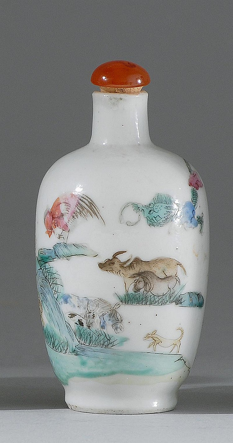 POLYCHROME PORCELAIN SNUFF BOTTLE In elongated ovoid form with zodiac animal design. Four-character Yongzheng mark on base. Height 2...