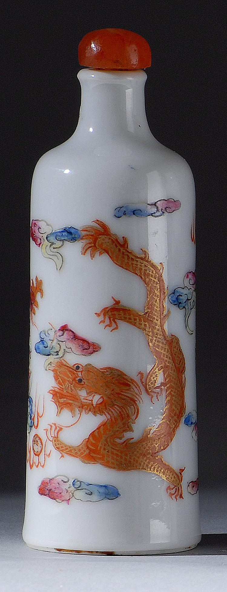 PORCELAIN SNUFF BOTTLE In cylinder form with dragon and phoenix design. Four-character mark on base. Height 3¼