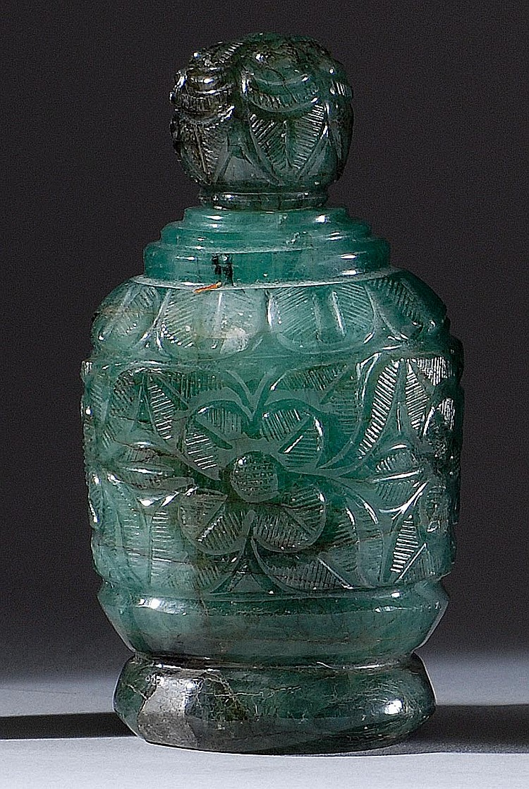 EMERALD SNUFF BOTTLE In temple jar form with Mogul-style floral carving. Conforming stopper. Height 3