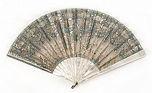 SILK, SILVER NETTING, AND MOTHER-OF-PEARL FOLDING FAN Leaf of blue-gray silk overlaid with silver netting and silver spangles and se...
