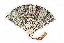 PAPER AND BONE FOLDING FAN Double-sided paper leaf lithographed with a pastoral scene of a shepherdess with her lambs amongst young...